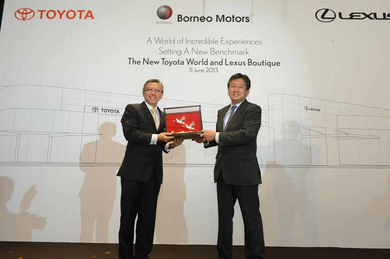 Gift Handover From Mr H Fukui To Mr Koh Ching Hong To Commemorate The Opening Of The New Lexus Boutique And Toyota World