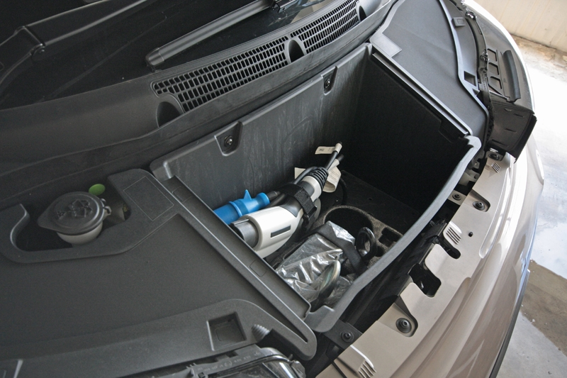 A compartment to store charging cable and tools