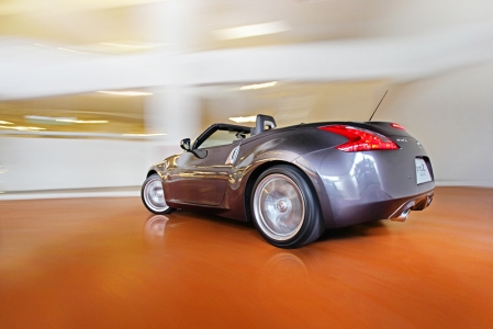 Like the coupe, the 370Z roadster is similar in dimensions save for the fact that it had its top chopped and replaced with a fabric folding roof that comes with a standard automatic latching power top. The 370Z roadster also boasts of an aluminium hood, door panels and trunk for better power to weight ratio while at the same time, the body structure's rigidity and stability were improved on, with additional structural reinforcement in both the A-pillars and side sills.