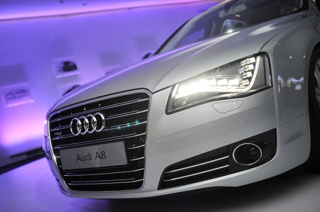 The new LED headlights give the new Audi A8 and A8 L (long wheelbase) an unmistakable appearance in daylight and after nightfall. The revolutionary optics used in these headlights is a departure from the tubular light modules commonly used today. The Audi flagship combines a new level of technical intelligence with intuitively simple operation. Its multimedia interface (MMI) includes a pioneering innovation: in conjunction with the MMI navigation plus navigation (standard), it has a touchpad. The MMI enables the driver to control many functions intuitively. The navigation destination, for example, can be entered by tracing the letters on the pad with a finger.