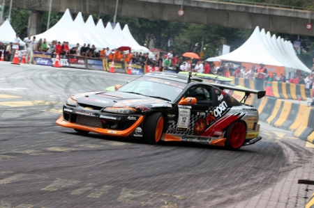 "Tengku Djan said, ""It is a great feeling to have won the overall Asian Championship, although it would have been better to finish with a win in Malaysia."" He crashed out at the first elimination round of the final 32 drivers, clinching the overall title with just 28 points ahead of Non Saranon."