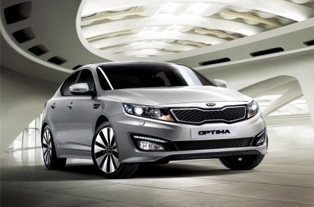 Longer, wider and lower than before, the Kia's coupe-like profile is accentuated by the low and sleek roof line. Still, Kia claims the interior to be spacious, and with class-leading levels of safety and luxury equipment, the Optima K5 will come with a black interior and 'sports package' as standard.