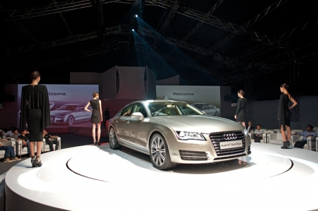 "With the A7 Sportback, the official car of this year's Audi Fashion Festival, Audi has once again broken new ground in design. Earlier this year, a distinguished jury panel of design experts had voted the A7 Sportback as winner of the ""Auto Bild"" Design Summit, thanks to top marks in proportions, styling, innovation, haptics and quality. Reinhold Carl, Managing Director of Audi Singapore: ""The Audi A7 Sportback is a beautiful car that commands your attention. Anyone with a taste for design will appreciate its proportions, styling, and the presence the car has on the road."""