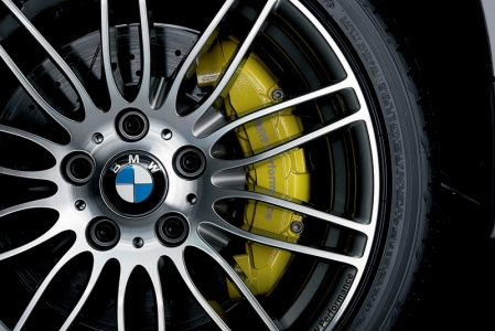 "BMW Performance sports brakes come with extra-large vented brake discs cross-drilled at the front and upgraded by slots in the discs for optimized cooling.  The six-piston fixed-caliper brakes on the front axle, in turn, come in brilliant BMW Performance Yellow and bear the words ""BMW Performance""."