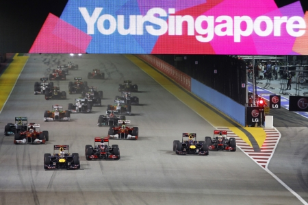 One point is all that separates Sebastian Vettel from his second successive Drivers' World Championship after the 24-year-old German and his Red Bull Racing team claimed their first victory on Singapore's Marina Bay Street Circuit on Sunday.