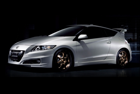 "To make 10 years of Hybrid power a very special milestone to remember, Kah Motors will also offer a Mugen Aero Package for the Honda CR-Z. The first 10 CR-Z customers will get this package free. This Aero Package can be applied to 6MT and CVT models. The design concept of the Mugen Aero Package is ""Sporty & Cool"". The package includes the following: Mugen front under spoiler, rear under spoiler, side under spoiler, front sports grille and rear wing. Designed and tested in the wind tunnel, the Aero Package not only enhances the sporty design of the 2012 CR-Z, it also generates additional down force from the rear wing, improving traction and high speed stability."