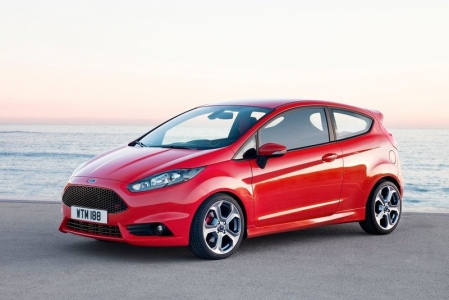 The exterior of the Fiesta ST has several alterations that include a large grille (that may have been inspired by a certain British Marque) that dominates the front fascia, a new front splitter, and a rear fascia shaped to resemble a rear diffuser. To further distinguish the ST from the normal Fiesta, the ST has a dual exhaust outlets, a new rear wing and tricked out 17 inch alloy wheels. Of course, a hot hatch is meant to scream in your face, and what better way to do it then to paint it in a bright Orange specifically made for the car?