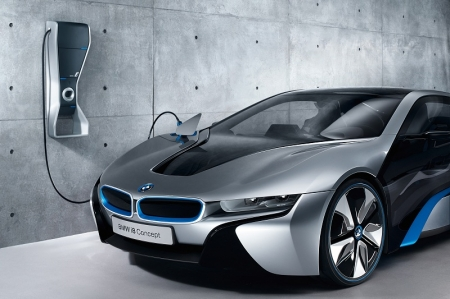 The emotional design of the BMW i8 Concept, which is on display in Singapore, ensures its qualities are clear for all to see. Its dynamic proportions give the BMW i8 Concept the appearance of surging forward before it even turns a wheel and lend visual form to its extraordinary performance. The sophisticated concept behind the upward-swiveling doors fixed to the A-pillars underlines the car's sporting capability and opens up access to the front and rear seats at the same time.  A series of air inlets allow the air to flow through and around the vehicle to optimum effect, ensuring extremely low drag. They also add visual emphasis to these advanced aerodynamics. Airflow plays an extremely important role at the rear of the vehicle as well. Intakes behind the passenger cell and at the rear provide a cooling flow of air through the engine compartment, while outlets in the rear diffuser and the flow of air around the rear wheels ensure the car is extremely efficient in terms of lift and down force at both axles.  The BMW i8, meanwhile, is designed from the outset as a plug-in hybrid sports car, with the emphasis on agile performance and outstanding efficiency. Pairing an exceptionally lightweight, aerodynamically optimized body with cutting-edge BMW eDrive technology, a compact, highly turbocharged 1.5-litre BMW TwinPower Turbo petrol engine and intelligent energy management, the BMW i8 marks the next stage in the evolution of the Efficient Dynamics strategy. It can operate solely on electric power, which means zero tailpipe emissions, and offers the dynamic performance of a sports car, with an expected 0-100km/h sprint time of 4.5 seconds. The BMW i8's 231 hp petrol engine sends its power to the rear wheels, while the 131 hp electric motor powers the front wheels.