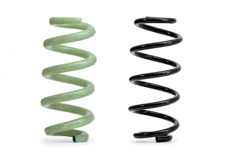 The GFRP spring (left) next to a 'traditional' steel type Whereas a steel spring for an executive class model weighs nearly 2.7 kilograms, a GFRP spring with the same properties weighs approximately 1.6 kilograms. Together, the four GFRP springs reduce the weight by roughly 4.4 kilograms, half of which pertains to the unsprung mass, helping the suspension to react more quickly to changes in the road surface and to absorb imperfections more effectively.The core of the springs consists of long glass fibres twisted together and impregnated with epoxy resin. A machine wraps additional fibres around this core - which is only a few millimetres in diameter - at alternating angles of plus and minus 45 degrees to the longitudinal axis. These tension and compression plies mutually support one another to optimally absorb the stresses acting on the component.The GFRP springs can be precisely tuned to their respective task, and the material exhibits outstanding properties. It does not corrode, even after stone chipping, and is impervious to chemicals such as wheel cleaners. Last but not least, production requires far less energy than the production of steel springs.