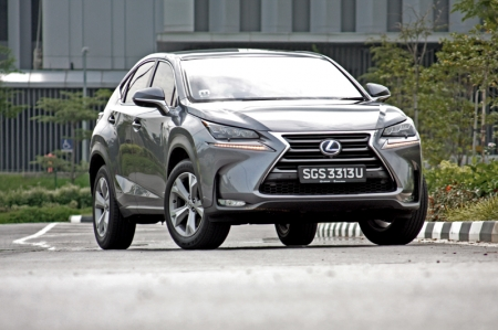 Ok, let's move on. The NX 300h looks rather radical compared to its peers in the segment though. There are bold lines, stunning creases, stylish head and rear lights; a lot of work went into designing the exterior itself. That front face with the highly detailed bumper finished with a one-piece spindle grille, looks ready to swallow anything in its way. The only downside are those wheels that still look undersized and out of place on the car. Oh, those are 18-inch mind you.