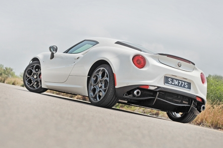 As I walked to our 4C test car, I couldn't help but wish they had given us one painted in red. The white paint on our car swallowed up all the curves and didn't do it justice. The 4C's shape was refined over many hours in the wind tunnel so that it works aerodynamically to provide negative lift at speed and a low Cd of 0.35.