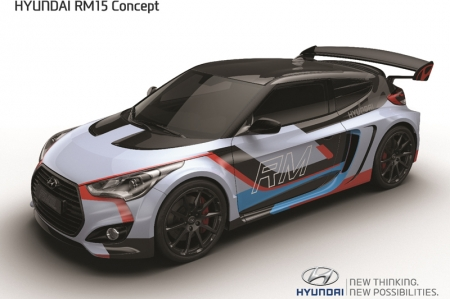Based on the Veloster RM shown at last year's Busan Motor Show, the new RM15 features a host of modifications that boost the latest model's performance, handling and efficiency. Total weight is reduced to 1,260 kg (a saving of 195 kg compared to an all-steel structure), weight distribution is more evenly balanced (43% front, 57% rear), the center of gravity is just 491 mm from the ground and aerodynamic downforce is 24 kg at 200 km/h, aided by a competitive lift-coefficient. Integrated sub-frame (front & rear) and a WRC-inspired roll-cage add extra stiffness to the structure, providing a firm foundation for the aluminium double-wishbone suspension, enabling it to give precise responses and consistent handling characteristics. RM15 rides on stylish 19-inch diameter mono block forged alloy wheels fitted with 235/35 R19 front and 265/35 R19 rear tyres.New vertical air-intake placed ahead of the rear wheel arches increase cooling airflow within the engine bay and enhances powertrain efficiency.