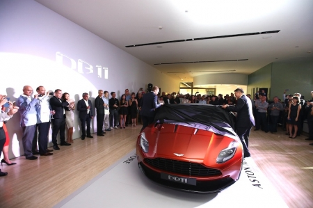 The DB11 showcases a fresh and distinctive design language, pioneering aerodynamics and a potent new in-house designed 5.2-litre twin-turbocharged V12 engine. Built upon a new lighter, stronger, and more space efficient bonded aluminium structure, DB11 is the most powerful, most efficient and most dynamically gifted DB model in Aston Martin's history. As such it is the most significant new Aston Martin since the introduction of the DB9 in 2003.
