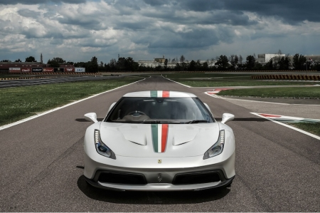 Designed in-house by the Ferrari Styling Centre, the 458 MM Speciale was built on the chassis and running gear of the 458 Speciale. Stylistically, the said owner was looking for extremely sporty lines and specified a 'visor' effect for the glasshouse: A black-painted A-pillar, very much in the style of the 1984 Ferrari GTO, helps provide a wraparound effect between the windscreen and side windows which melds into a single, seamless glass surface. This solution simultaneously lowers the roofline and lends an aerodynamic sleekness to the full volume of the swept-back C-pillar.