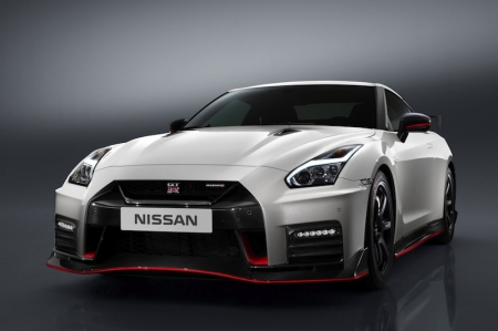 Like the standard car, the GT-R NISMO's front end features a fresh face with a dramatic new bumper. However on this model, it is made entirely from carbon fibre to reduce weight. Then to help cool the car's high-output engine, the dark chrome V-motion grille has been enlarged to collect more air; the redesign has been carefully shaped to improve airflow around the vehicle and generate a high level of downforce, while at the same time directing air around the wheels to improve the aerodynamics. The GT-R NISMO generates more downforce than any other Nissan production car to date, which results in exceptional high-speed stability.Power comes from a twin-turbocharged 3.8-litre V6 delivering 592 bhp; the engine features a pair of high-flow, large diameter turbochargers used in GT3 competition, and power is sent to all four wheels via a six-speed dual-clutch paddleshift gearbox.