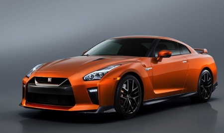 The new GT-R's exterior gets a complete makeover across the front end. The new chrome in matte finish 'V-motion' grille with an updated mesh pattern has been enlarged to provide better engine cooling, while the bumper sides were optimally reshaped to retain the car's air drag and downforce. A new hood, which flows upwards from the grille, has been significantly reinforced, contributing to stability during high-speed driving. A freshly designed front spoiler lip and front bumpers with finishers situated immediately below the headlamps generates high levels of front downforce.