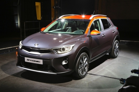 The design of the car is recognisable as a Kia thanks to key signature design elements, such as the 'tiger-nose' grille. Designed in Europe, in collaboration with Kia's Korean design studio, the body blends sharp horizontal feature lines with softer sculpted surfaces; the Stonic's 'Targa'style roof enables buyers to choose a two-tone paint finish, inspired by the design of the 2013 Kia Provo concept. It will be available in Europe with up to 20 two-tone colour combinations, with a choice of up to five distinctive colours for the roof.