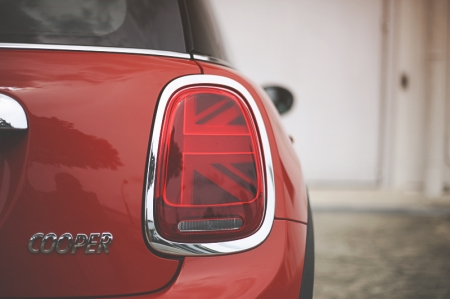 "The new Cooper sports refreshed LED head lamps and incorporates daytime driving lights and turn indicators. At the rear, creative Union Jack tail lamps hark back to the MINI's English roots, and never fail to make people go ""Waaaahhhh, so cool!"""