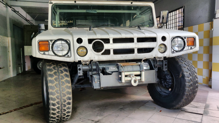 Strictly Off-road Use Only  Seen here is a right-hand drive BXD10 military-spec vehicle with a soft top. Due to them being mil-spec, the Japanese military kept all Vehicle Identification Number (VIN) documents, meaning these units cannot be registered for road use.