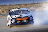 The RMR Red Bull Hyundai Veloster rally car utilizes a custom suspension with a lot of travel for the jumps rallycross cars have to make.