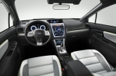 "A large multifunction display sits in the centre panel, including the three different displays for navigation, car audio and vehicle information feature touch panel technology. Like the Impreza concept, we find no mirrors but rather, the ""EyeSight"" driving assist system, which feeds video to a monitor on the dash from cameras mounted high up on the door line."