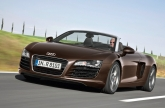 The Audi R8 Spyder 4.2 FSI quattro is capable of a top speed of 300 km/h, and comes standard with the R tronic, a highly efficient sequential six-speed transmission. Shift commands are transmitted electrically; a hydraulic system changes the gears and manages the clutch. The R tronic offers both an automatic and a manual mode, both of which allows the driver to choose between two shift programs. In manual mode, the driver changes gears using the joystick on the centre tunnel or with the paddles on the steering wheel. At high load and engine speed, gear changes take less than a tenth of a second. The Launch Control program ensures an optimal start, as it controls the engine speed and the engagement of the clutch to accelerate the open-top two-seater with the ideal wheel slip. 