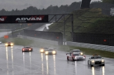 The race started in pouring rain with the safety car leading for the first five laps, with the race starting effectively from the sixth lap. On the first corner of that lap the second-position starter, the No. 46 S Road MOLA GT-R (Ronnie Quintarelli), ran off the track. Meanwhile, the pole-sitting No. 39 DENSO SARD SC430 (Hiroaki Ishiura) began to lose ground steadily and fell behind the pack. In both cases, the tyres chose by these two teams for the start did not fit the track conditions, forcing them to make early tyre changes. Also, the No. 100 RAYBRIG HSV-010 (Takuya Izawa) and No. 32 EPSON HSV-010 (Ryo Michigami) returned to the pit early to change tyres. These events put the No. 24 ADVAN KONDO GT-R (Bjorn Wirdheim) in the lead initially, with the No. 12 CALSONIC IMPUL GT-R (Joao Paulo Lima de Oliveira) and the No. 23 MOTUL AUTECH GT-R (Benoit Treluyer) in hot pursuit not far behind. On the twelfth lap, De Oliveira in car No. 12 and Treluyer in No. 23 passed No. 24 (Wirdheim) in quick succession. After that, Wirdheim (No. 24) was also passed by the No. 6 ENEOS SUSTINA SC430 (Kazuya Oshima).
