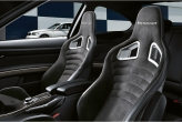 Sweet BMW Performance sports front seats in bucket motorsport design and finished in black Alcantara offer perfect support and superior seating comfort, with the side airbags also integrated in the seats.