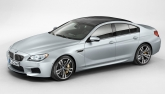 From the side, the first four-door Coupe in the BMW M GmbH ranks is clearly distinguishable from the BMW M6 Coupe thanks to its rear doors and 113-millimetre longer wheelbase. The low roofline flowing smoothly into the rear, the swage line - which takes in the door openers - and side windows extending well into the C-pillars accentuate the dynamically stretched silhouette.