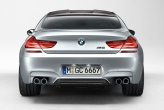 Prominently flared wheel arches draw the eye to a track width specific to the BMW M6 Gran Coupe.